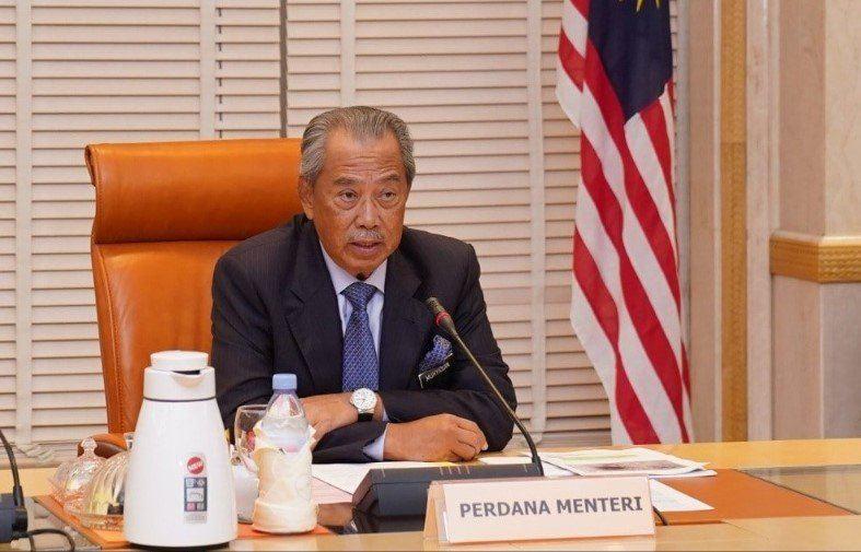 Muhyiddin to reshuffle cabinet in bid to keep Umno, says report