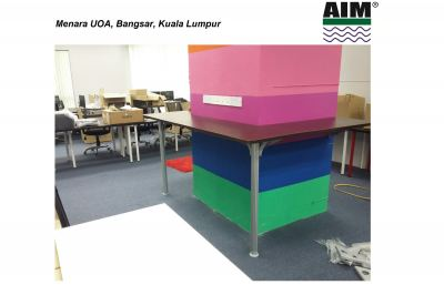 Colourfull pillar with high table for relax area
