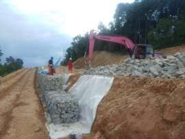 Installation of gabion wall as part of slope protection for gas pipeline, Pengerang, Johor