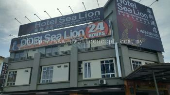 Sea lion laundry and hotel billboard at bayu tinggi klang