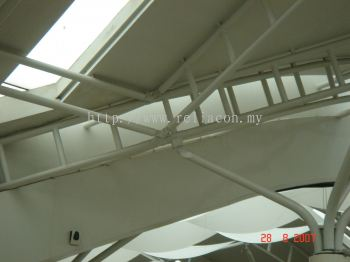 A closer look of the tree columns supporting the roof structure. The tree columns are bent circular hollow sections.