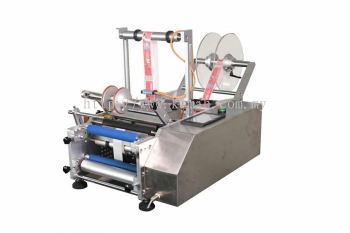 Semi-automatic flat labeling machine