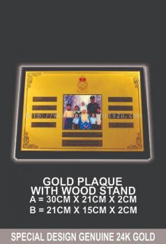GOLD PLAQUE WITH WOOD STAND