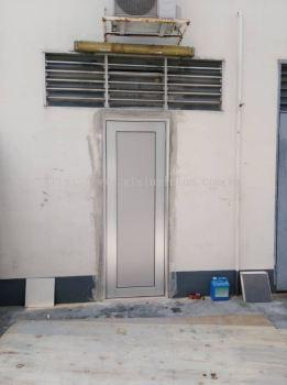 Store aluminium ( silver) swing door with composite panel